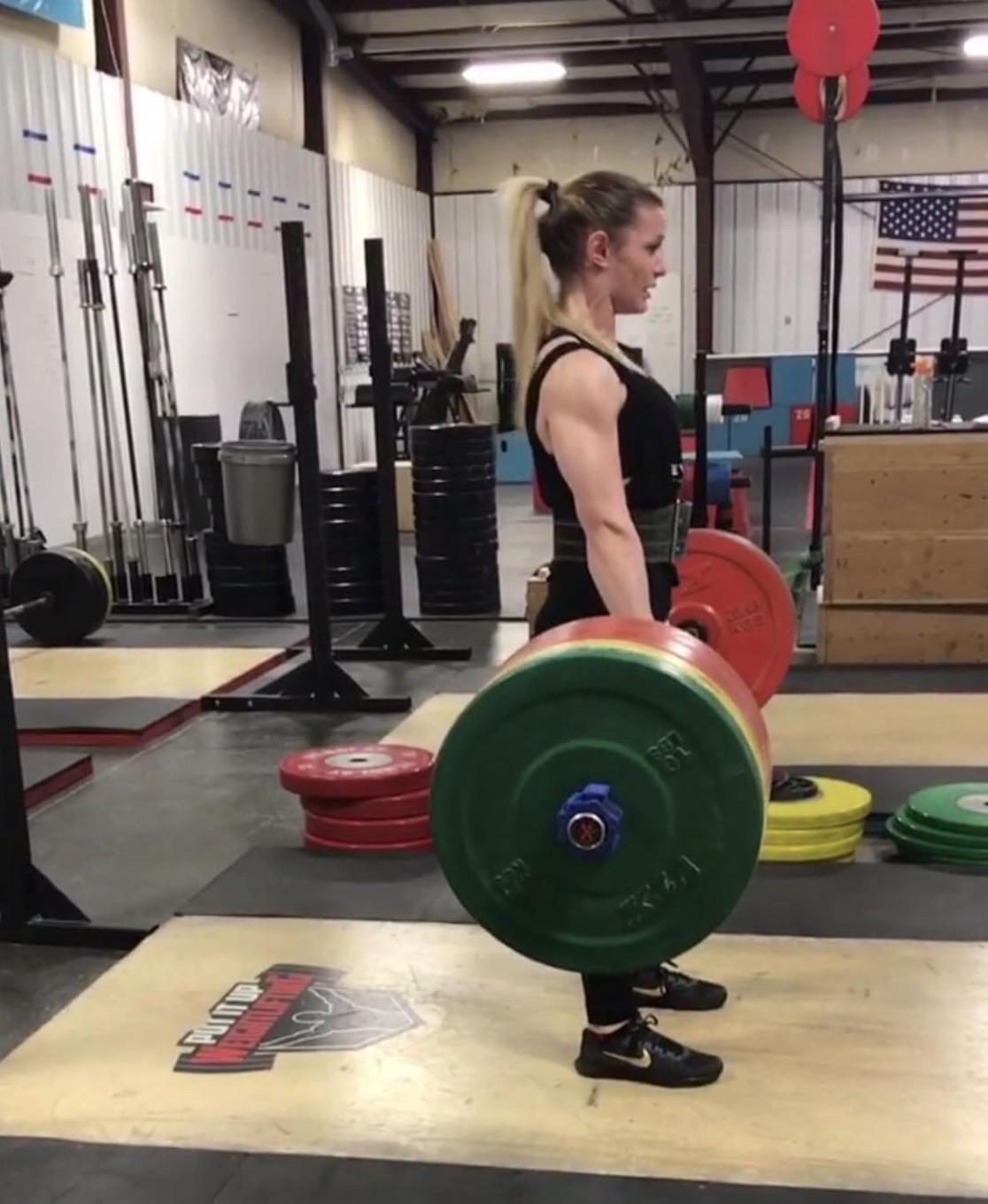 CrossFit athlete Kyra Milligan performing deadlifts