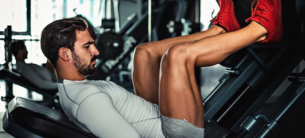 Working out with barbells or exercise machines for best muscle and strength gains.
