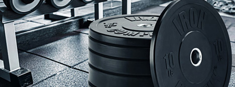 Iron Company rubber bumpers for commercial gyms, weight rooms and crossfit