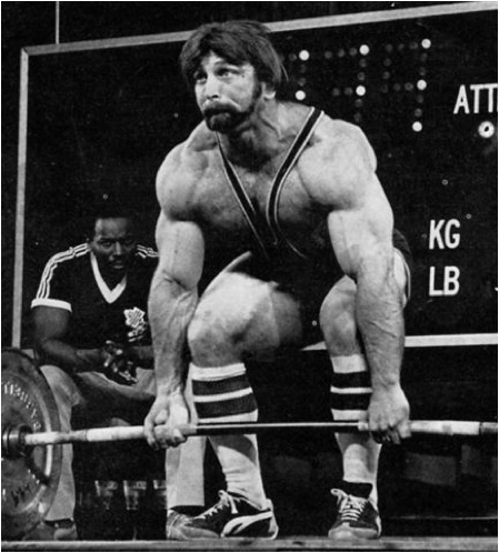 Powerlifter Roger Estep barbell deadlifting while demonstrating a thickly muscled physique