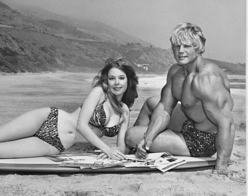 Betty Weider and Dave Draper employed by Joe Weider shown on a southern California beach.
