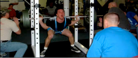 Improper Olympic Barbell Squatting Technique in Squat Cage