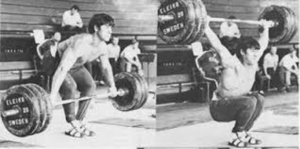 Weightlifter David Rigert snatching barbell