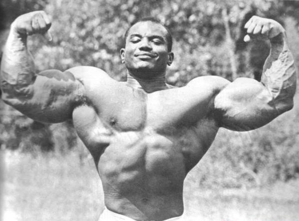 """Mr. Olympia Sergio Oliva """"The Myth"""" displaying some of the biggest arms in bodybuilding."""