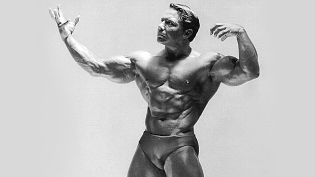 Bodybuilding Legend Bill Pearl displaying his massively muscular biceps and triceps muscles.