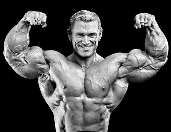 Bodybuilder Lee Priest Double Bicep Pose - Progressive Weight Training