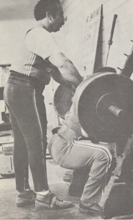 Powerlifter George Frenn spots Roger Estep on barbell squat