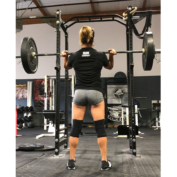 IRON COMPANY and Crossfit athlete Jackie Perez using rubber bumper plates, Olympic barbell and squat rack.